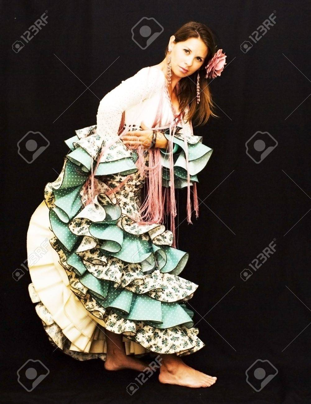 Beautiful young girl with typical dress of the city of Seville in Spain on black background Stock Photo - 19406712