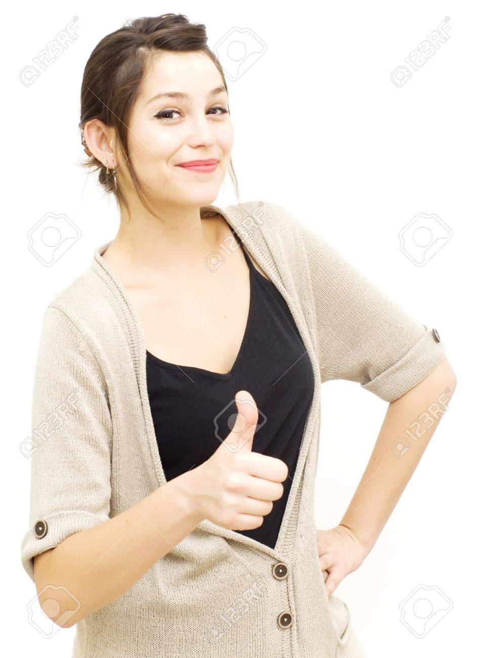 Portrait of a young woman with cardigan and her thumb up over white background - 20670777