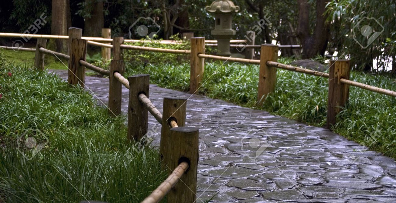 Stock Photo   Stoned Road With The Wooden Fence In A Japanese Garden