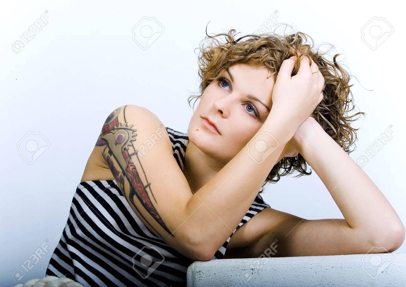 Curly brunette girl stripping