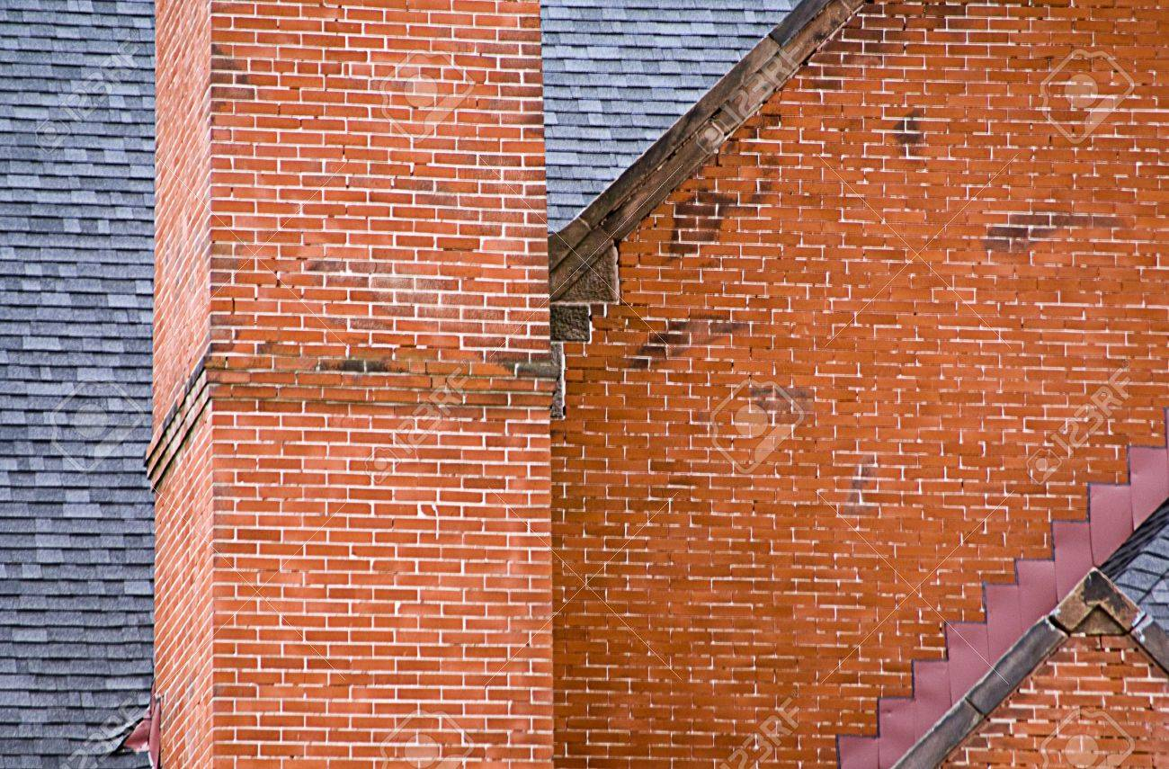 A Close Up View Of Red Brick Building Chimney And Slate Roof Stock