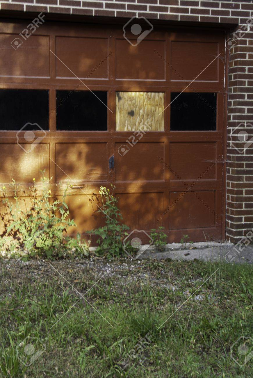 A spot of sunlight on the red door of a garage.  Stock Photo - 16680078