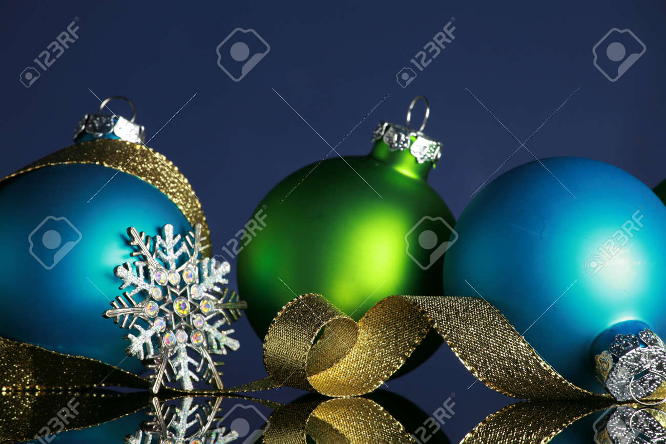 Christmas ornaments and gold ribbon on dark blue background, focus ob blue ball and ribbon Stock Photo - 3854319