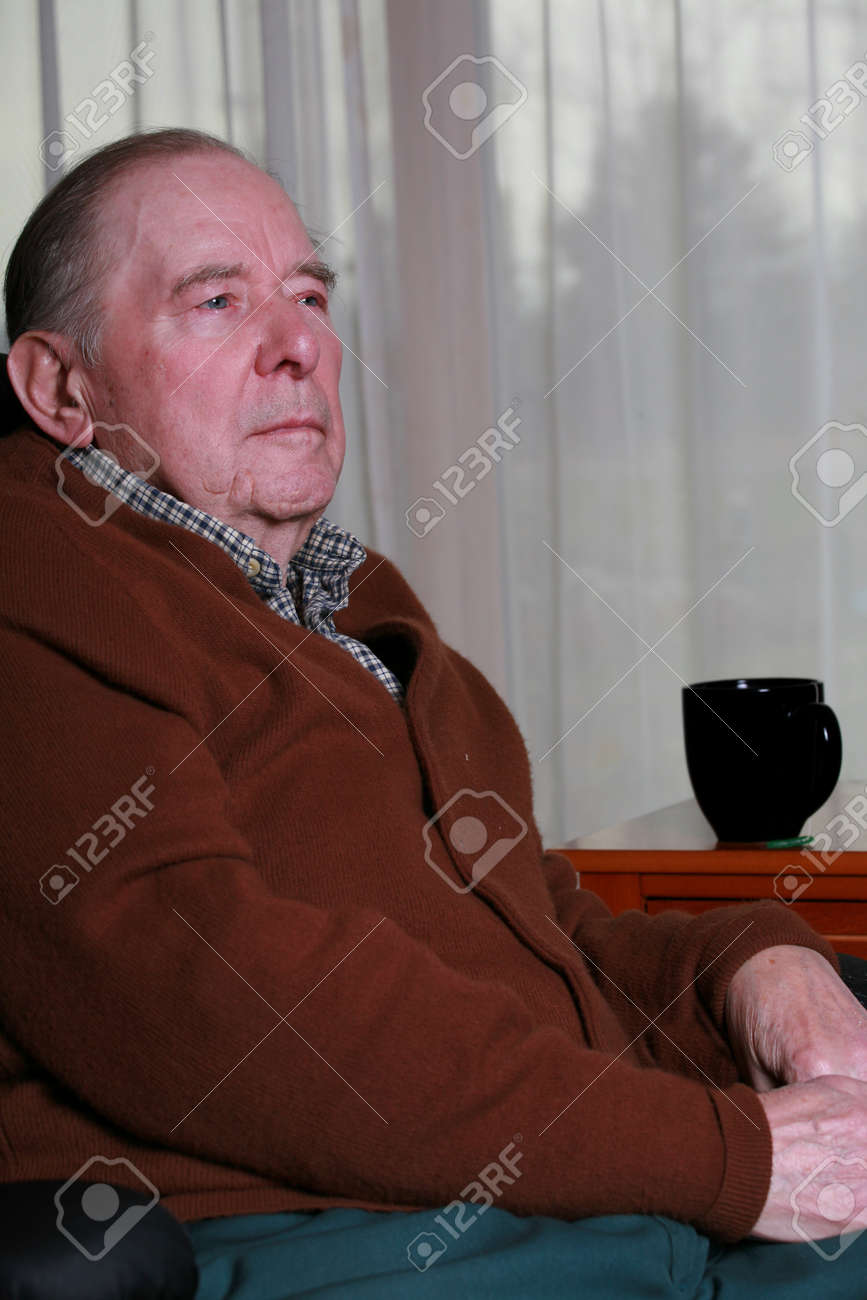 Man sitting in chair side - Elderly Man Sitting In Chair Side Profile Serious Expression Stock Photo 3953477