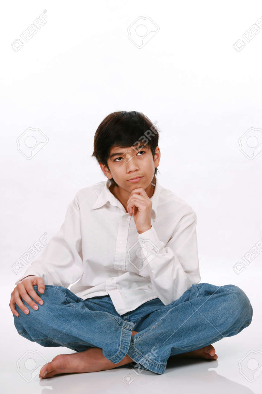 Twelve year old boy sitting, thinking with chin on hand Stock Photo - 4478715