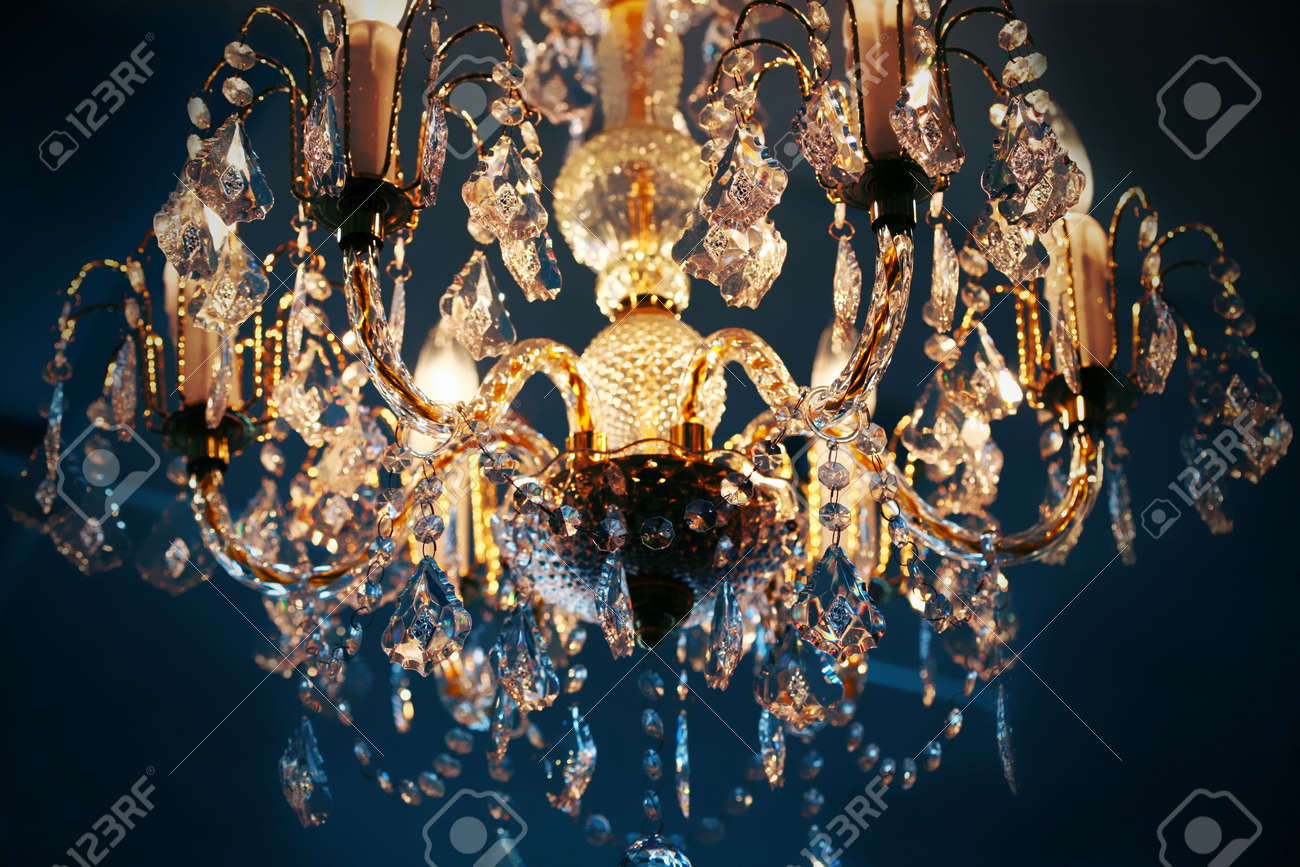 Elegant crystal chandelier hanging against blue background stock elegant crystal chandelier hanging against blue background stock photo 5506089 arubaitofo Choice Image