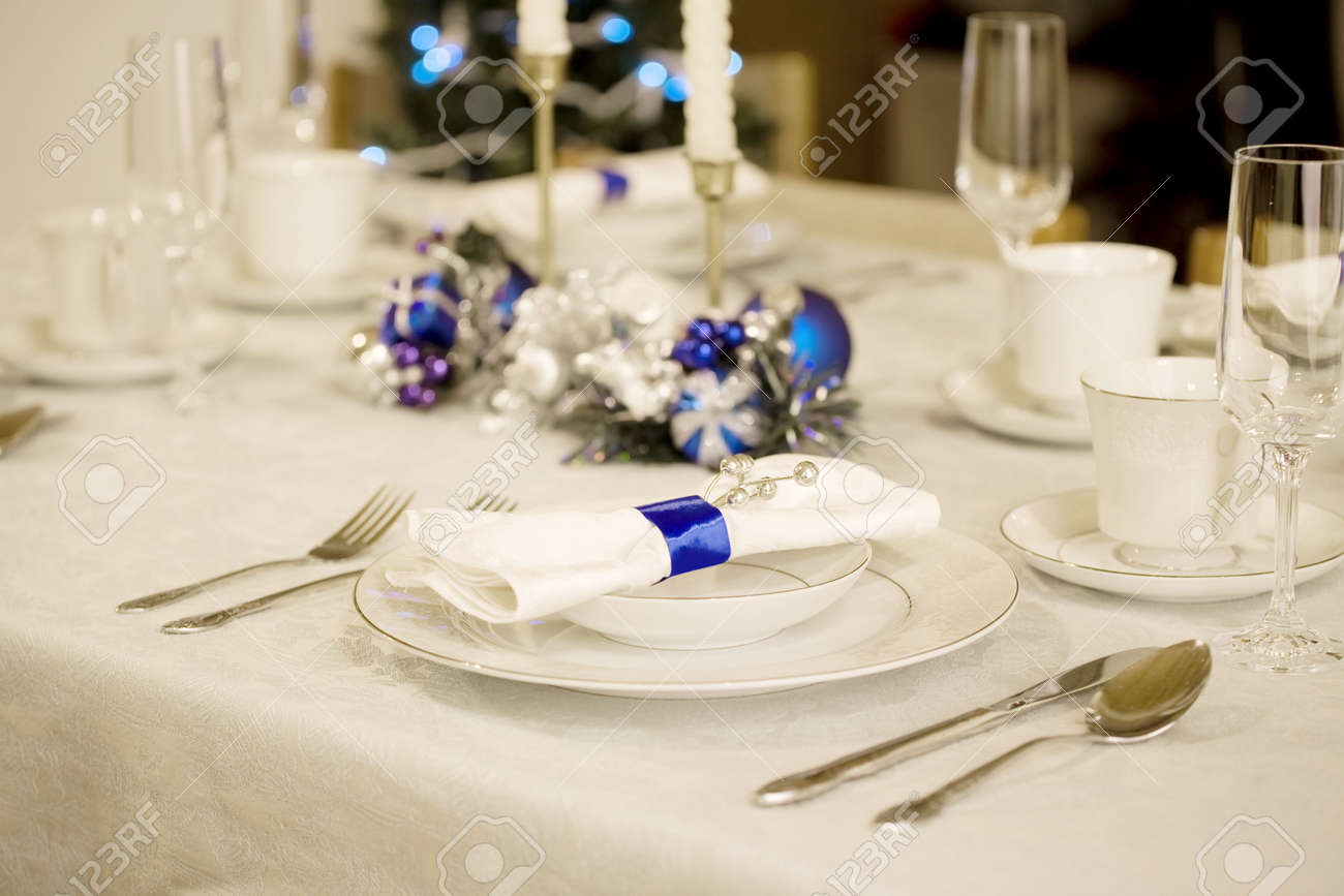 White christmas table decor - Elegant Blue And White Christmas Table Setting Stock Photo 5876256