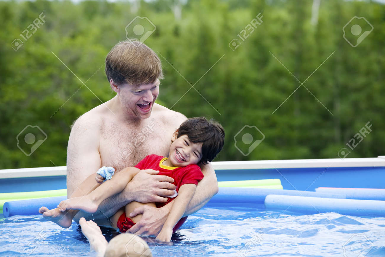 Father Holding Disabled Son In Pool Stock Photo, Picture And Royalty ...