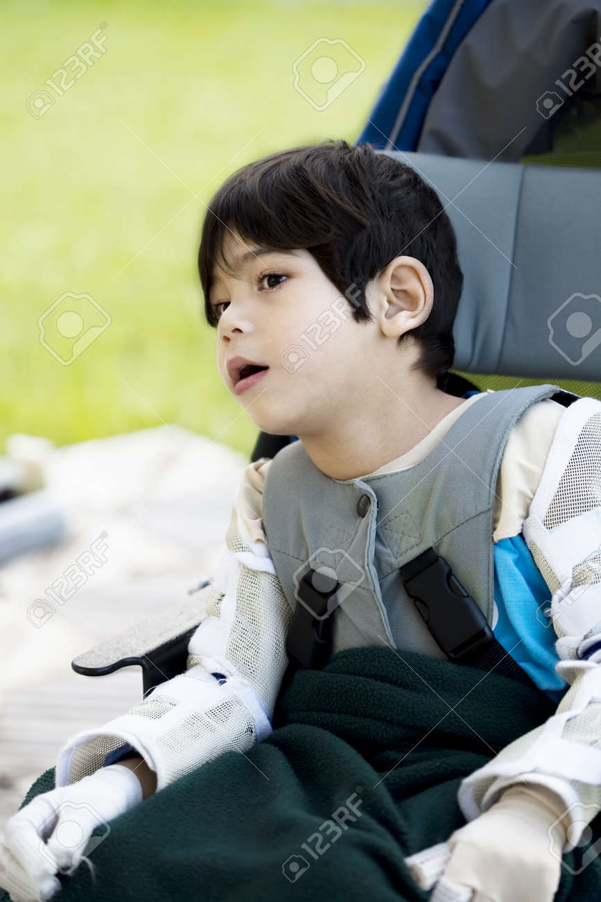 Four year old boy disabled with cerebral palsy sitting outdoors in wheelchair Stock Photo - 10002496
