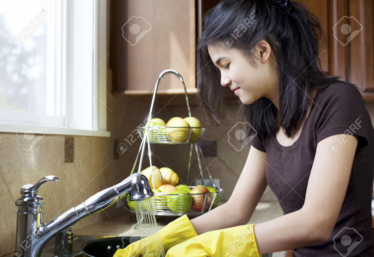 Kitchen Sink With Clean Dishes teen girl washing dishes at kitchen sink stock photo, picture and