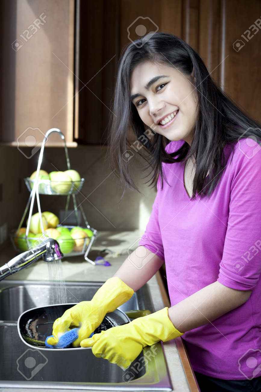 Kitchen Sink With Clean Dishes teen girl happily washing dishes at kitchen sink stock photo