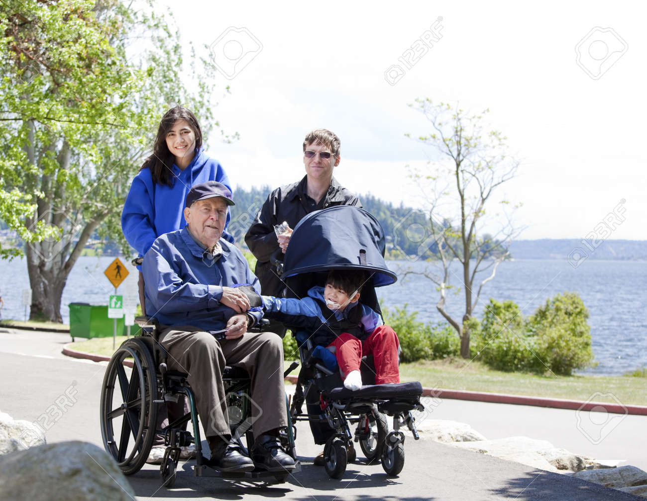 Family with disabled senior and child walking outdoors Stock Photo - 14505761