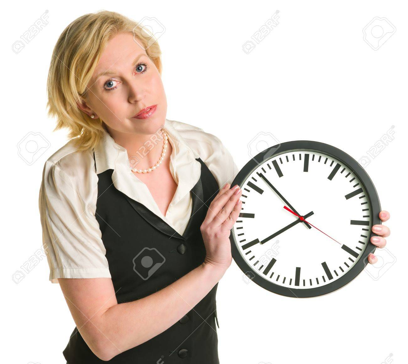 Woman holding and showing a clock, white isolated background. Stock Photo - 12300061