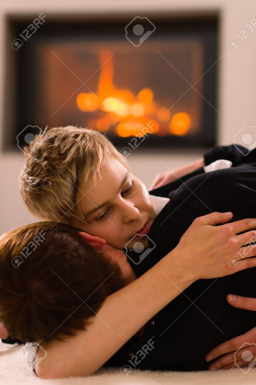 A Portrait Of A Lesbian Couple In Love, Fireplace On Background ...