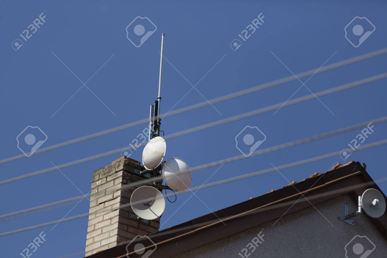 wifi dish and antenna on the roof of house - access point to