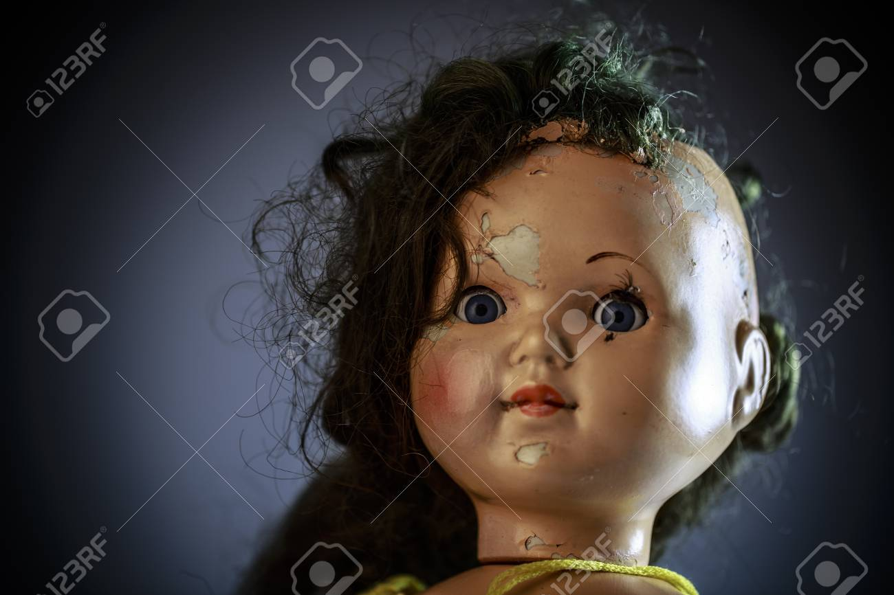head of beatiful scary doll like from horror movie evil face