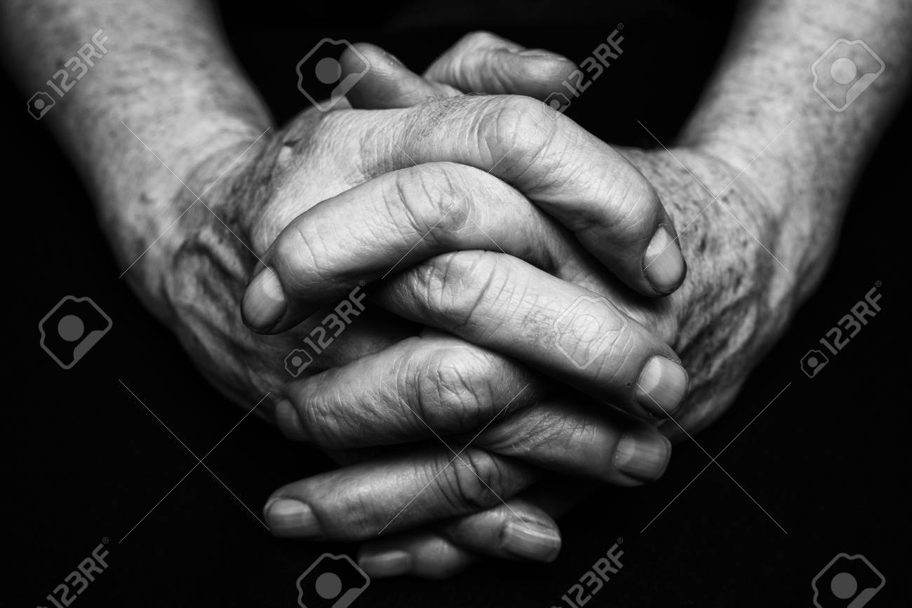 Old hands of senior clasped together black and white photography stock photo 72969390