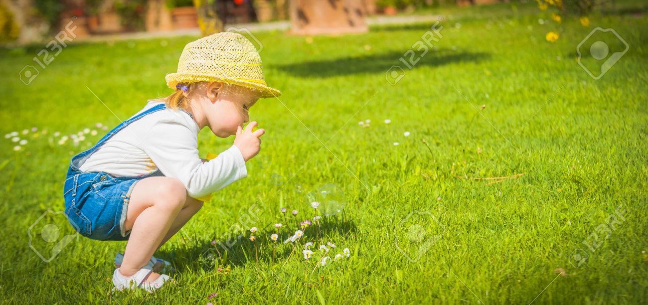 Little helper on the green grass in summer day - 29284330