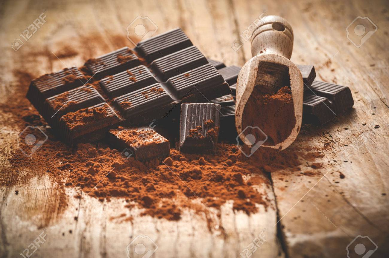 Noble dark chocolate on a wooden table in vintage style. - 35299773