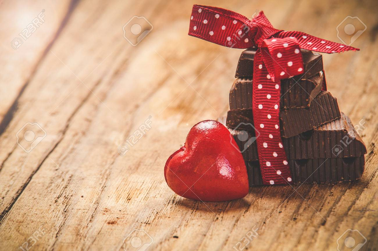 Chocolate with ribbon and heart on St. Valentine's day love. - 35300602