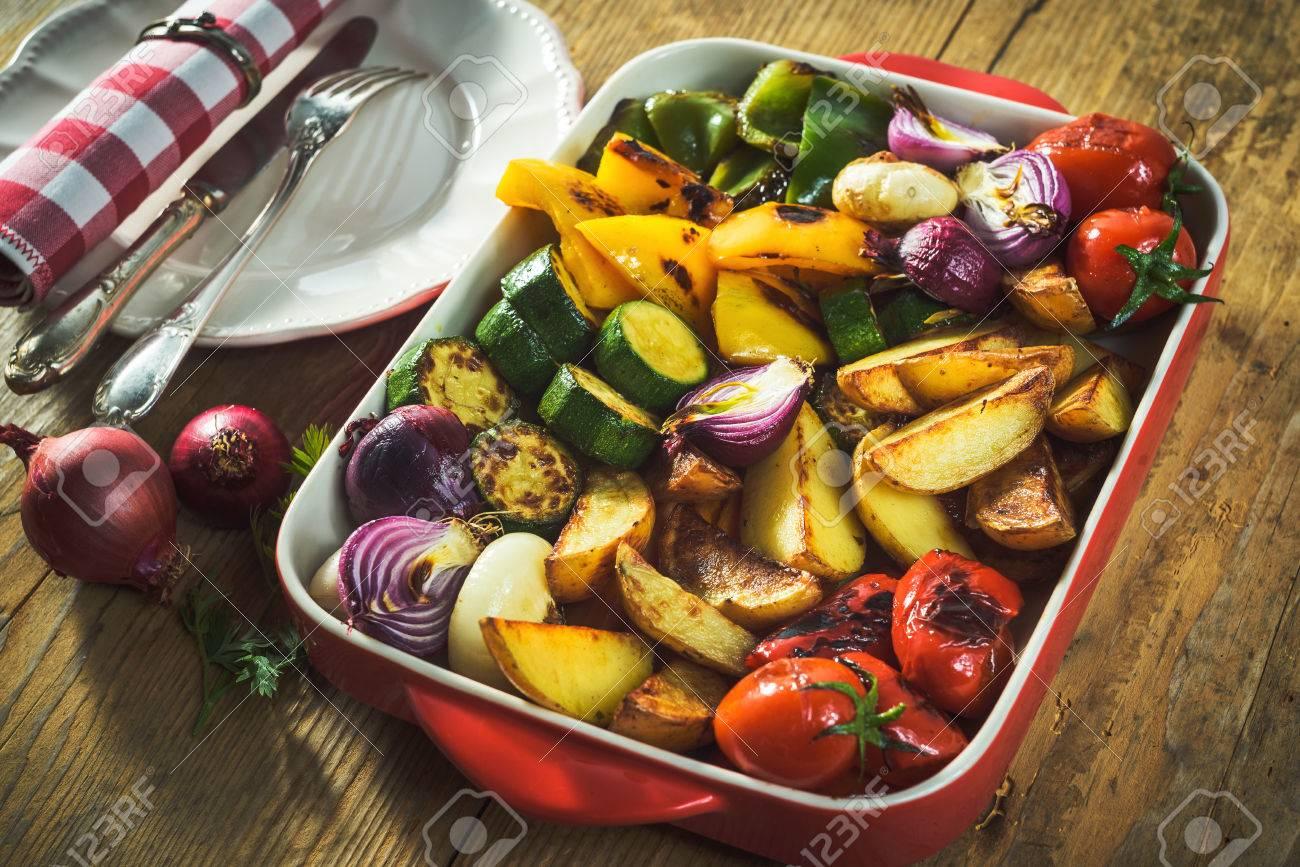 roasted vegetables in a ceramic pot - 53755424