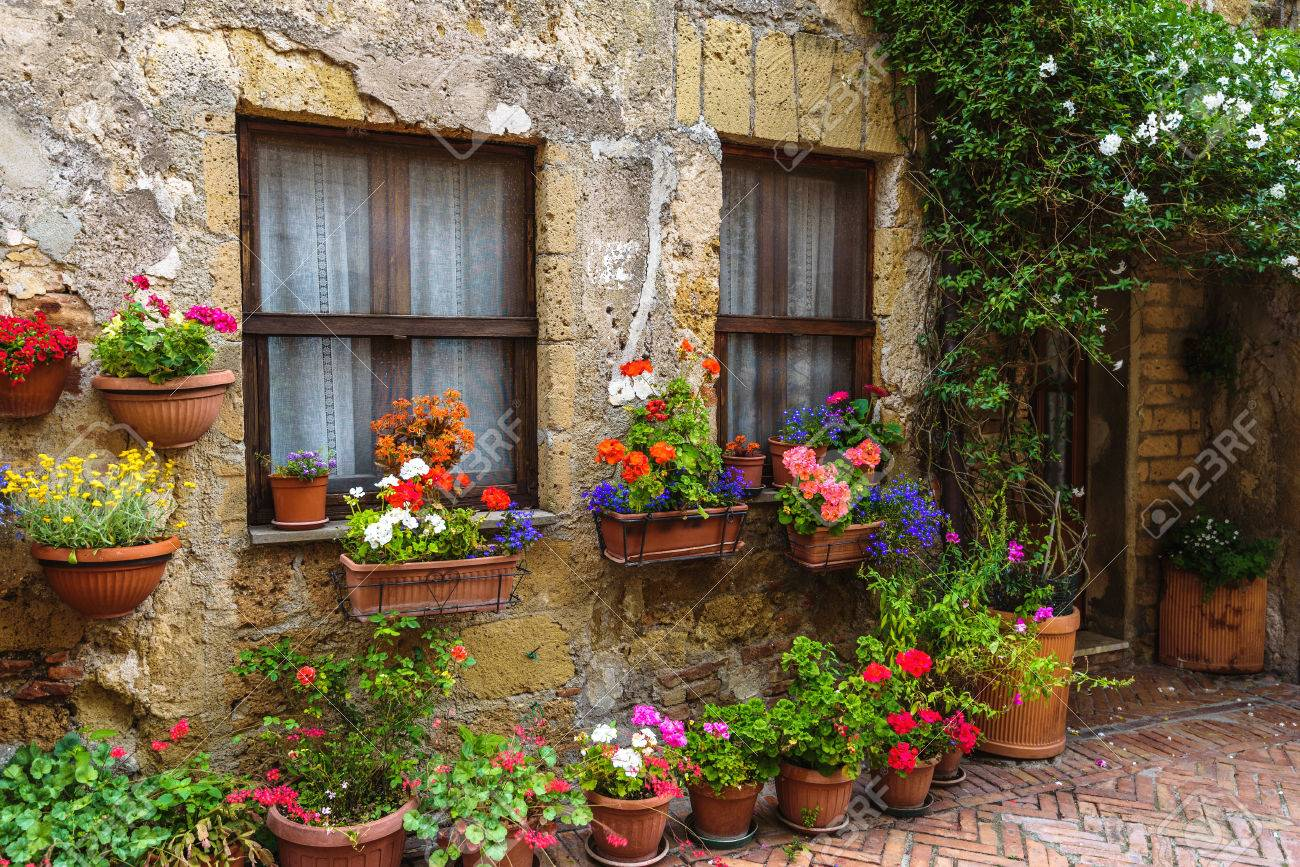 Flower filled streets of the old Italian city in Tuscany. - 60010427