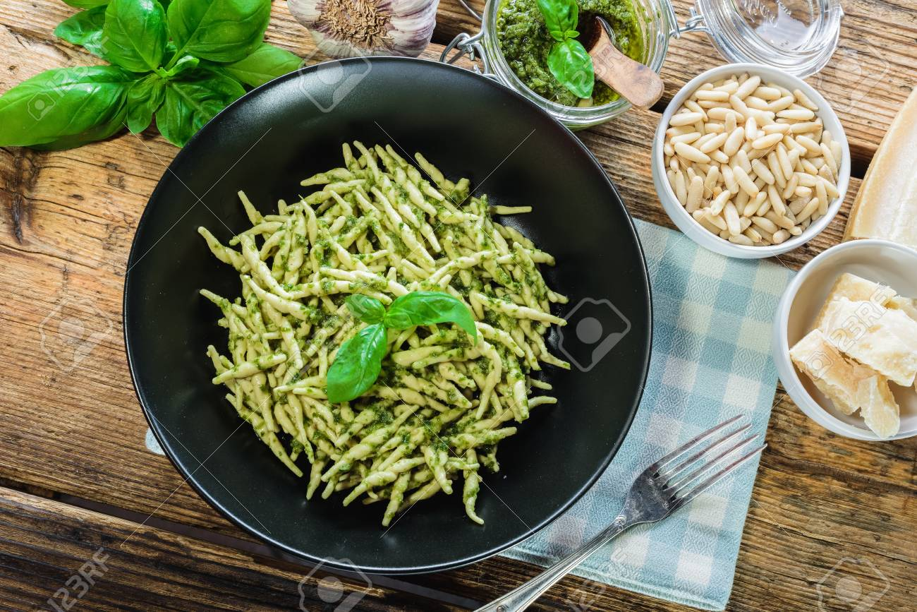 Trofie pasta with vegetarian sauce, pesto with pine nuts and basyli. - 71051969