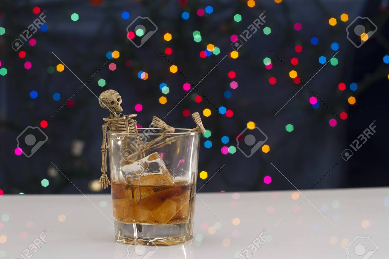 Skeleton with a Whisky. Alcoholism problem Stock Photo - 11492900