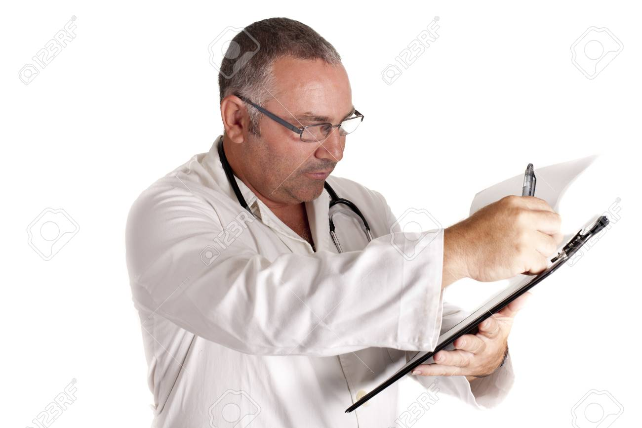 a doctor looking at his notes on their patients Stock Photo - 15236636