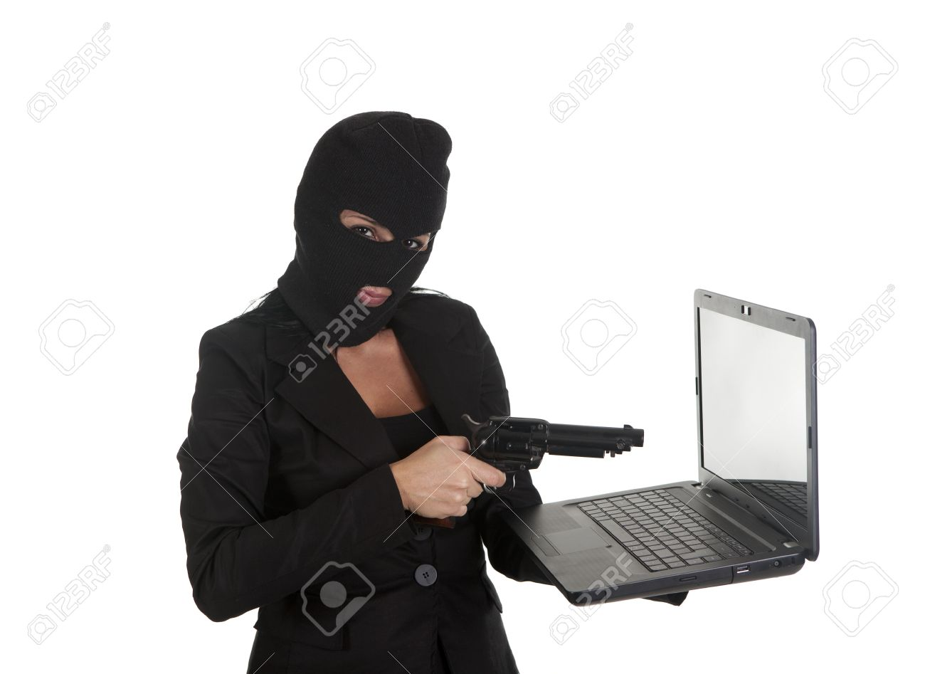 a hacker, committing a crime  through laptop Stock Photo - 16407713
