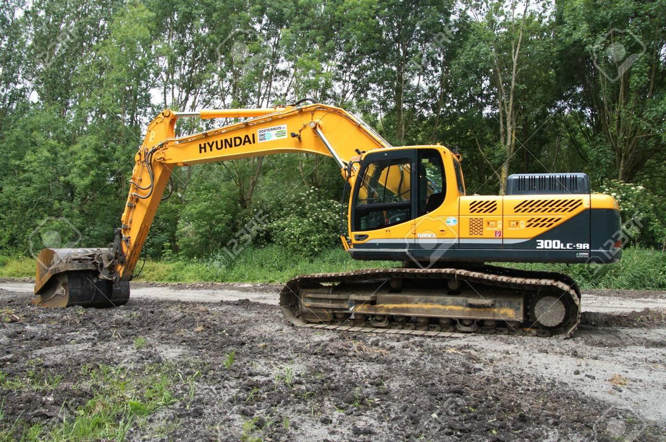 Stock Photo - Yellow Hyundai Robex 300 lc 9 Crawler Excavator
