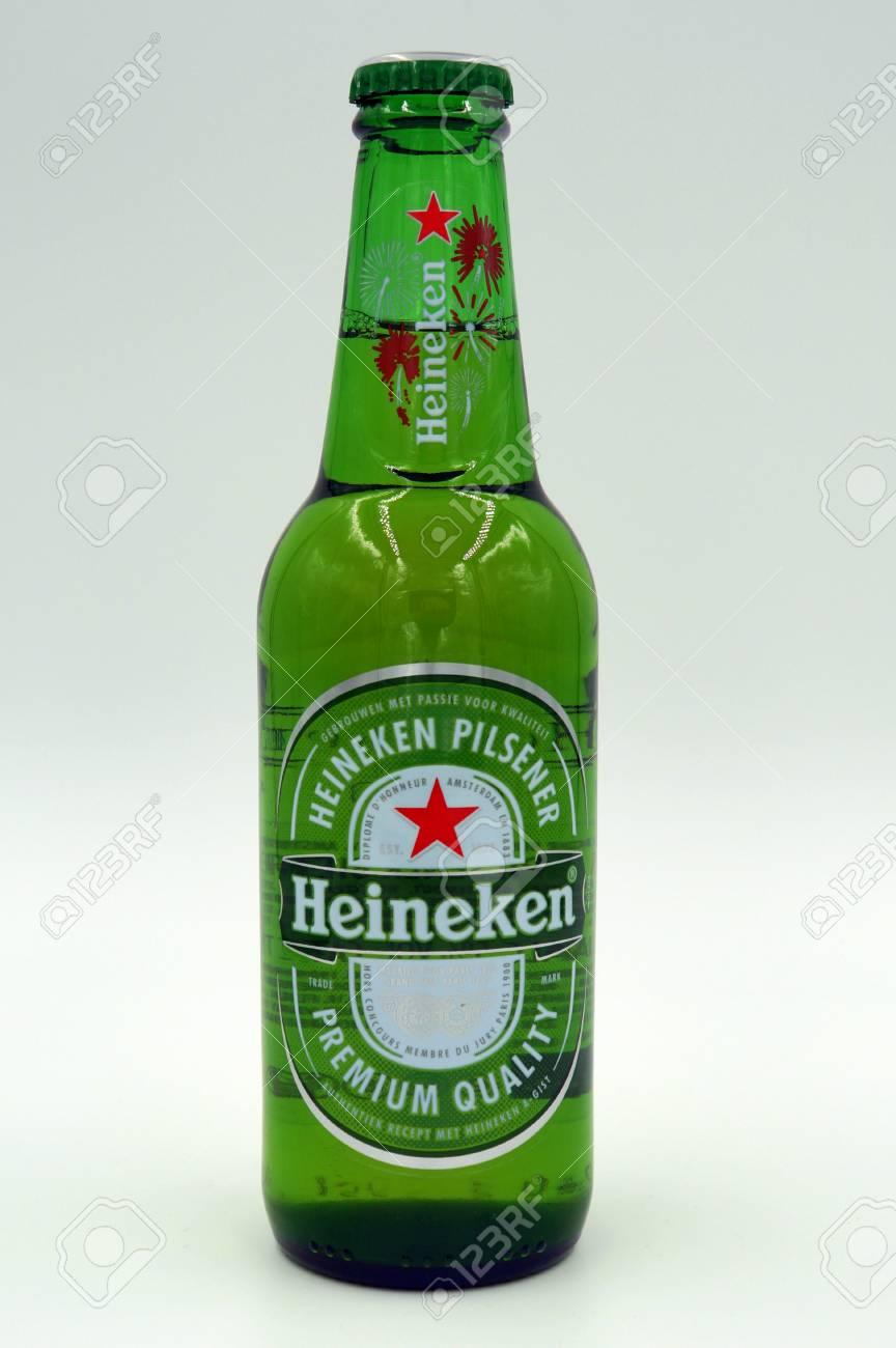 Bottle of Heineken Lager Beer. Heineken Pilsner is a pale lager styled beer brewed by the Dutch brewing company Heineken International in Zoeterwoude. - 91488740
