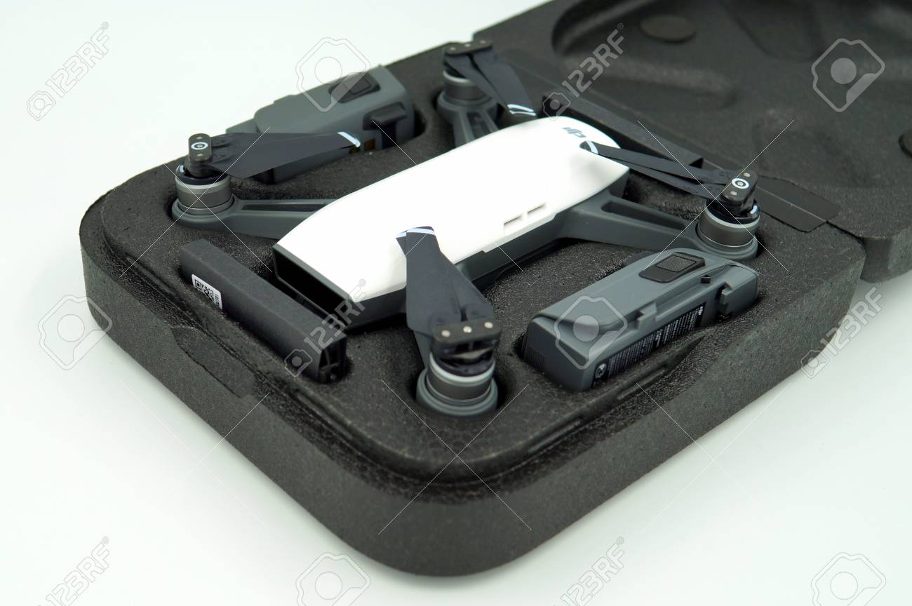 Top View Of DJI Spark Alpine White Drone Quadcopter And Battery