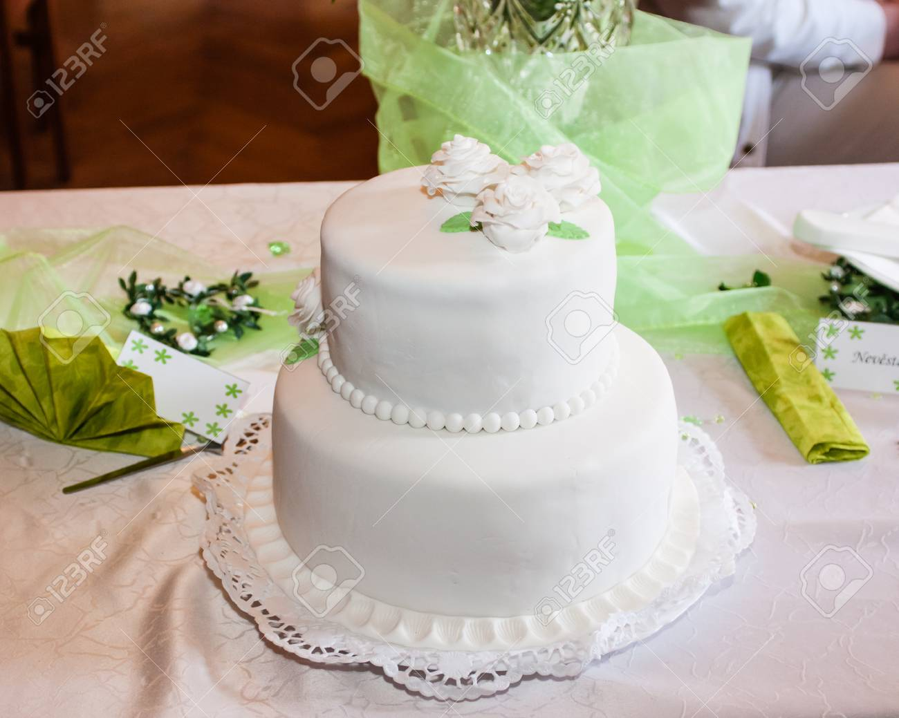 White Wedding Cake With Green Decors And Background Stock Photo ...