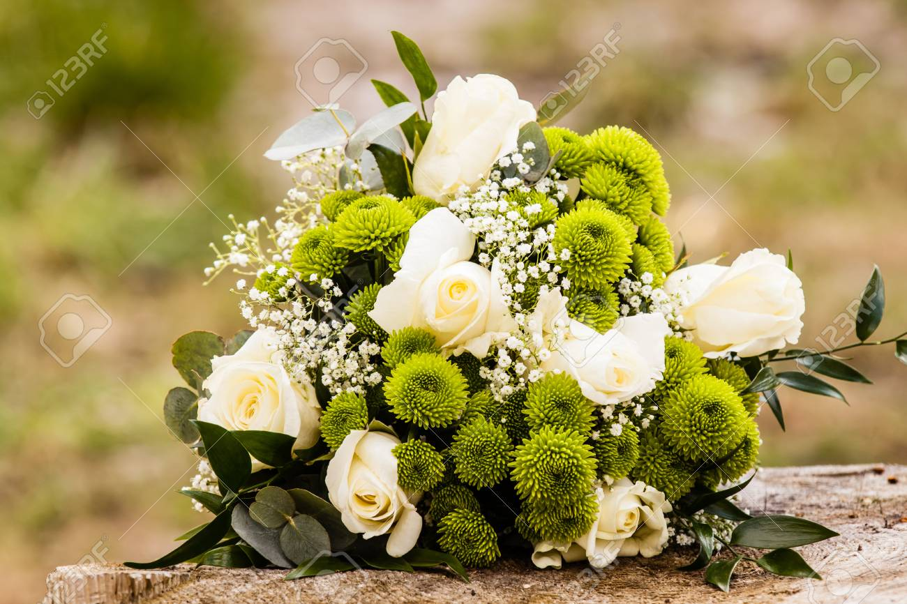 White And Green Colors Wedding Flowers With Roses Stock Photo