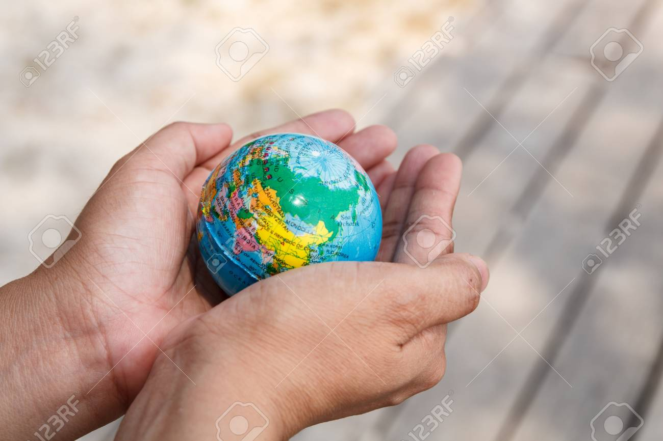 Concept of woman hand protect the Earth Stock Photo - 19139869