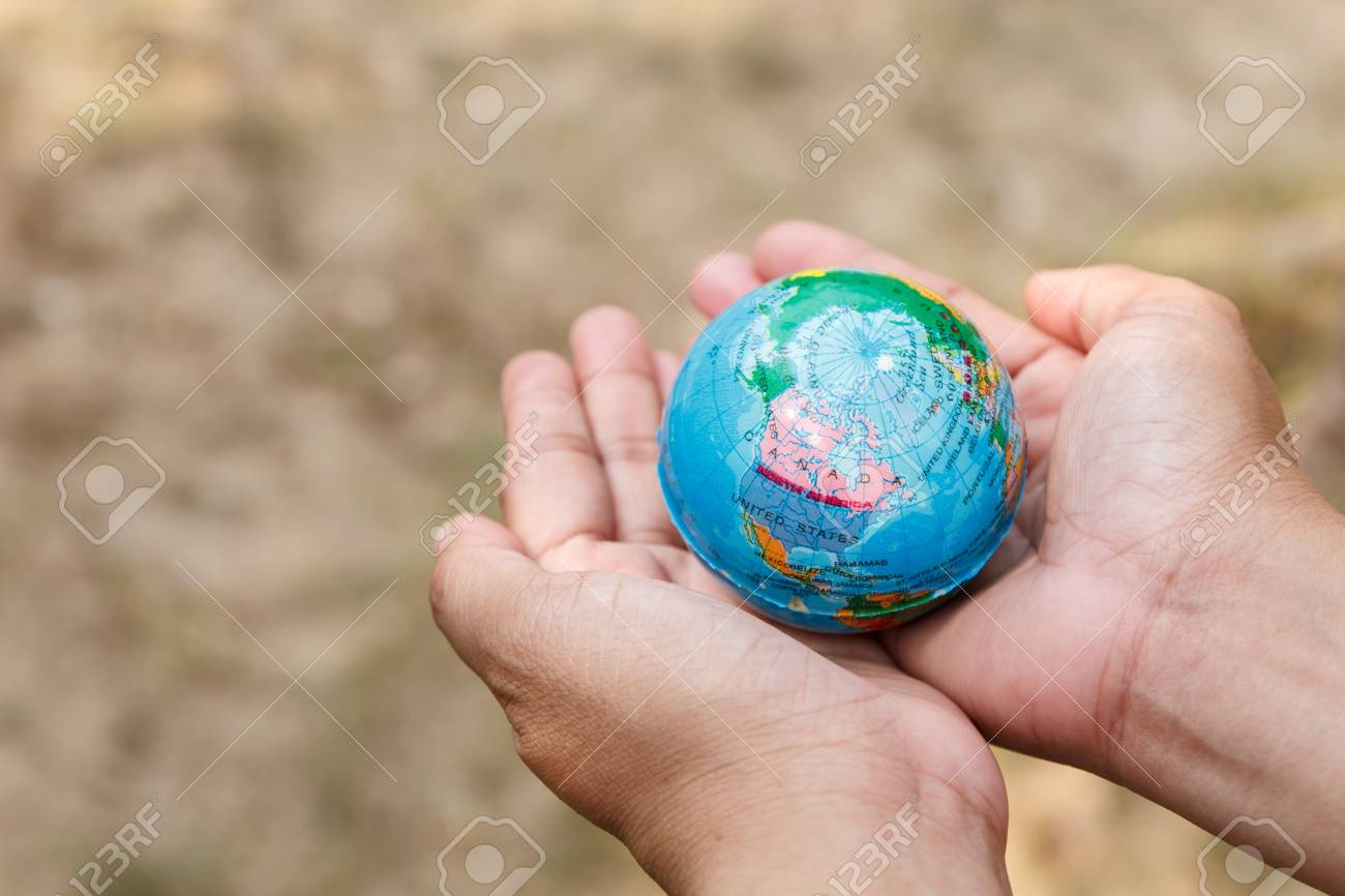 Concept of woman hand protect the Earth Stock Photo - 19139870