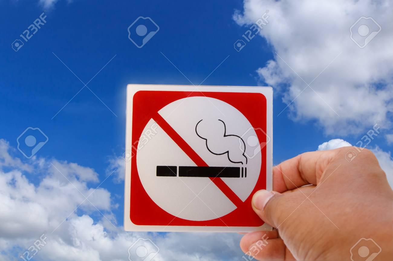 Concept of no smoking symbol on blue sky background Stock Photo - 19752772