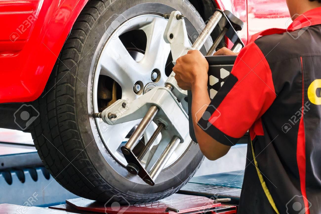Wheel Alignment Machine >> Car Wheel Fixed With Computerized Wheel Alignment Machine Clamp