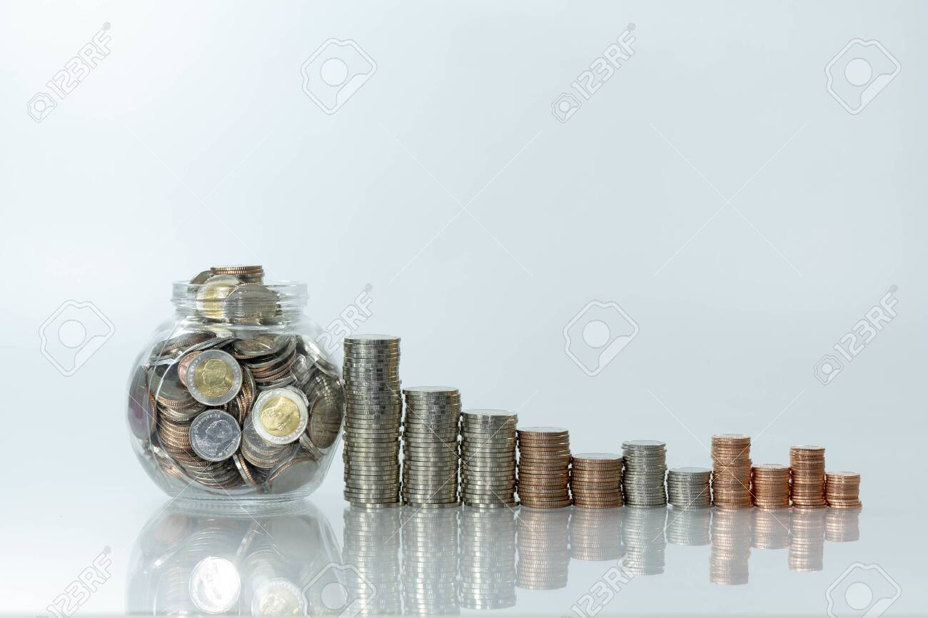 Stack of coin on white table and blur background, selective focus - 150363125