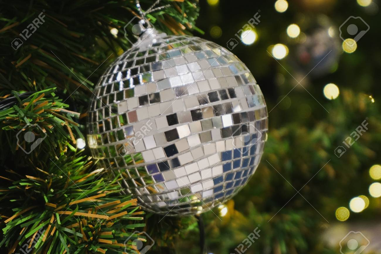 Christmas Disco Ball.Christmas Tree Decorated With Grungy Mirror Disco Ball