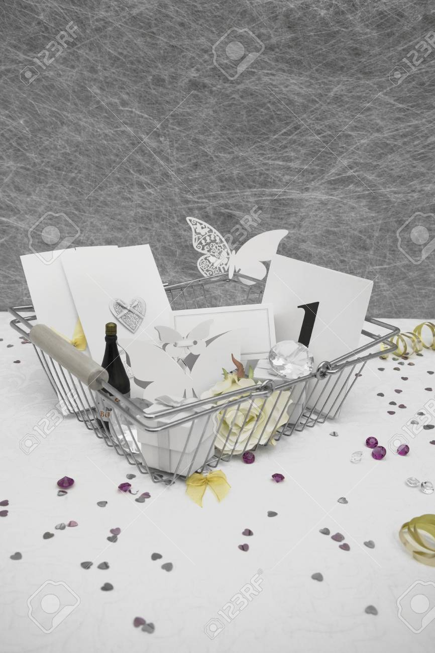 Wedding Favors In A Shopping Basket On A White Tablecloth With ...