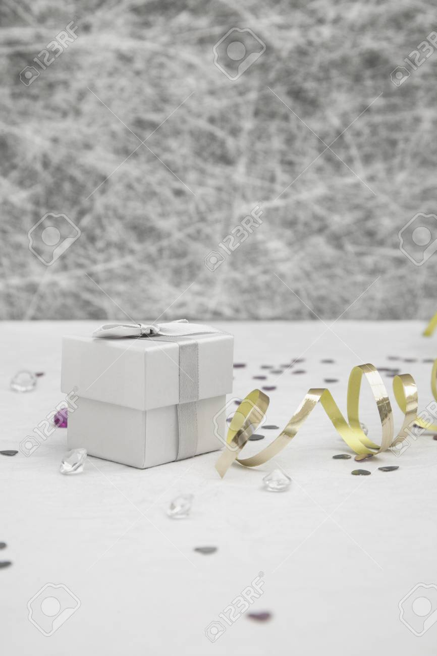 Wedding Favor Box On A White Tablecloth With Gold Ribbons, Silver ...