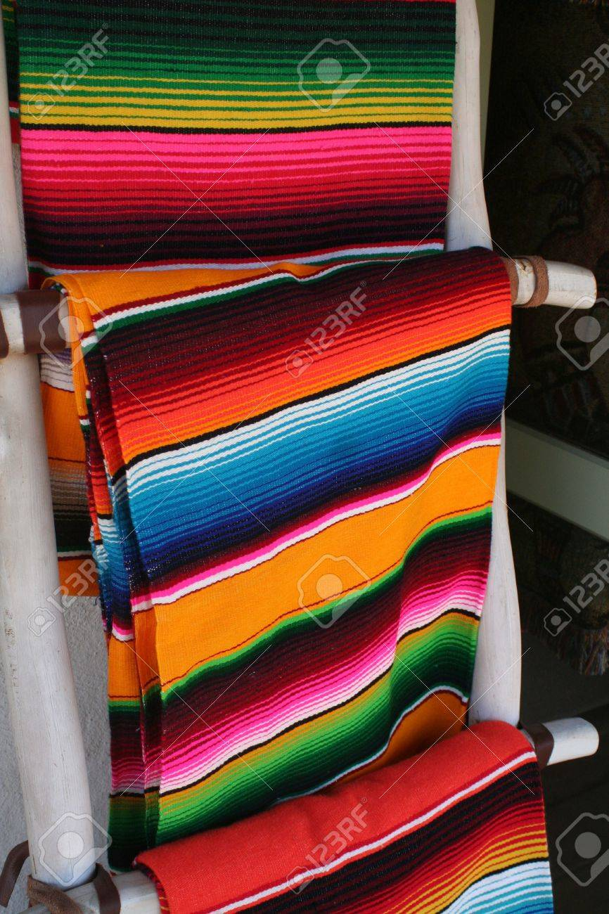 several colorful mexican wool blankets hung on display stock  - several colorful mexican wool blankets hung on display stock photo