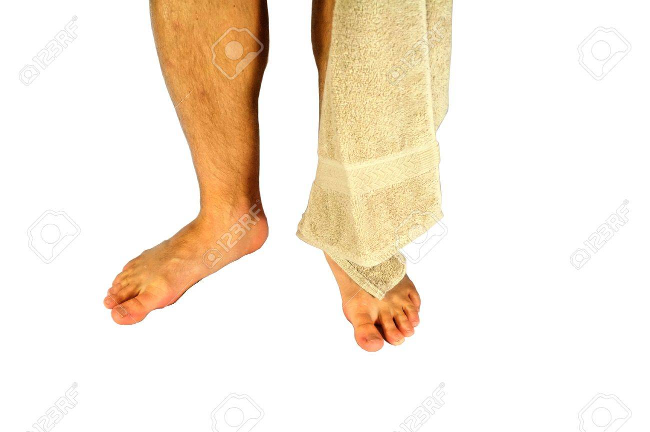 A Man S Lower Legs And Feet With A Towel Isolated On White Stock