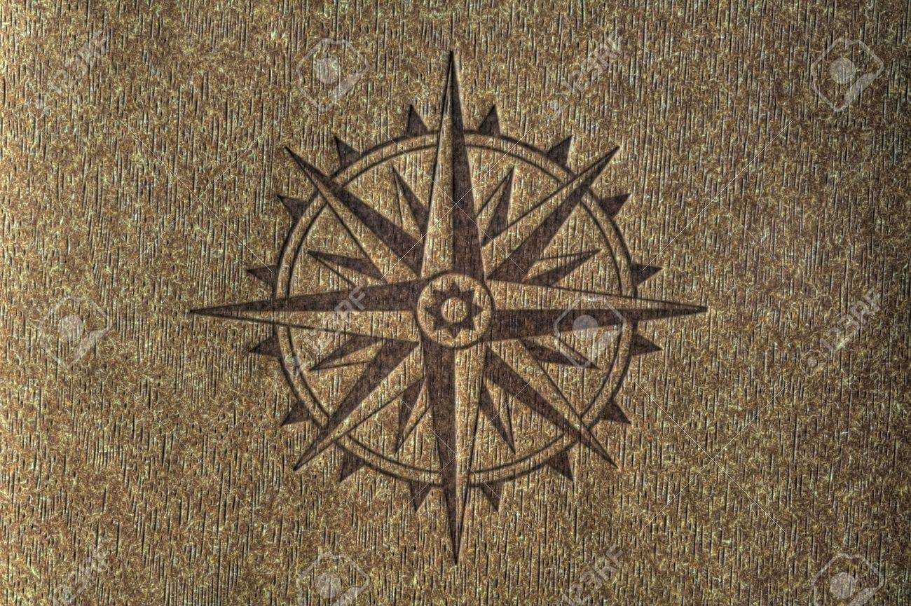 A compass rose imprinted on a wood texture with copy spce. Stock Photo - 5735966