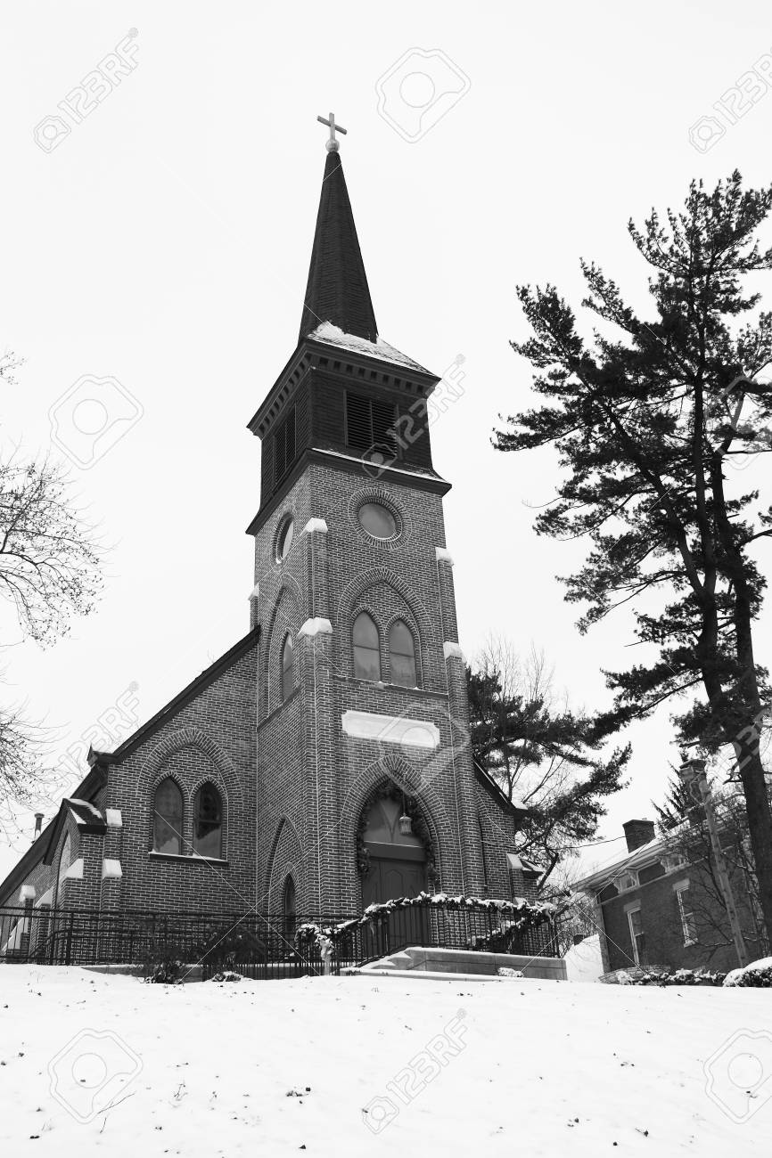 This old church sits on a hill and is blaneted by winter snow. Stock Photo - 6304828