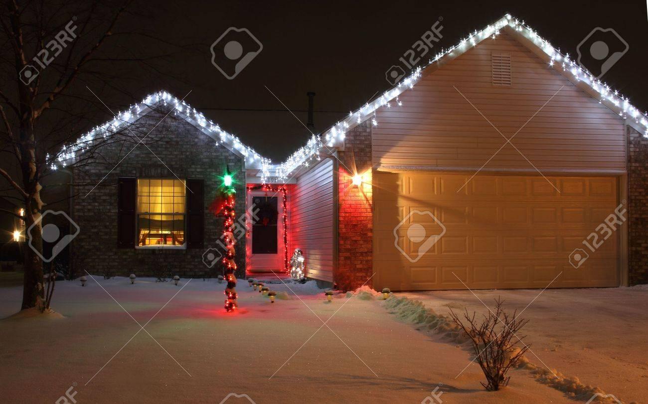 Led Christmas Lights On House.A Home Decorated With Led Christmas Lights