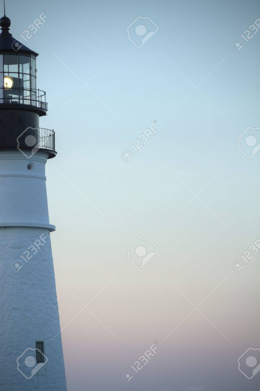 Close up of a light house beacon with the evening sky in the background. Stock Photo - 8840809
