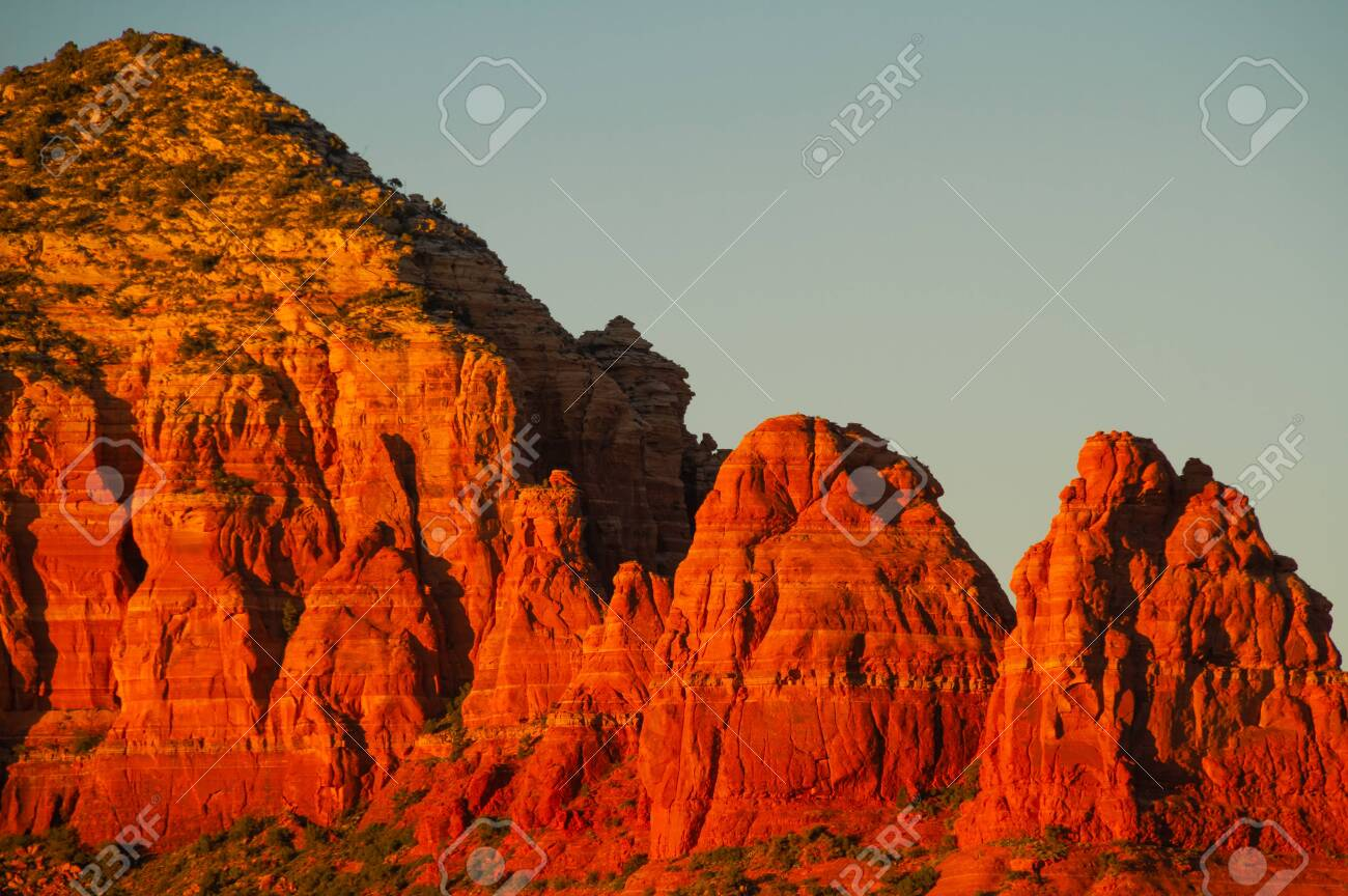 Evening light reflected on the cliff sides of the mountains of Sedona, Arizona. - 120425733